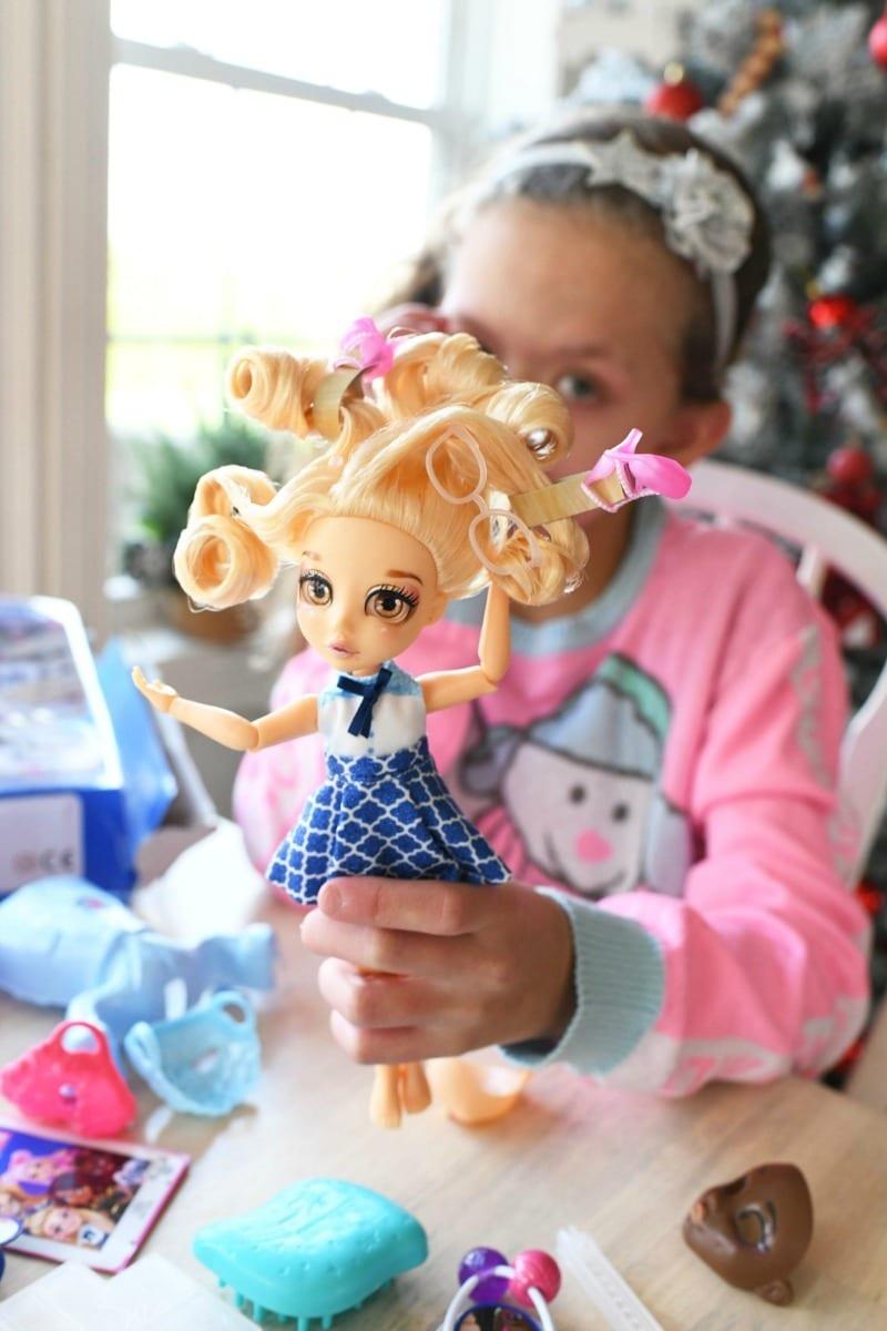 Blonde FailFix Doll in a girls hand.