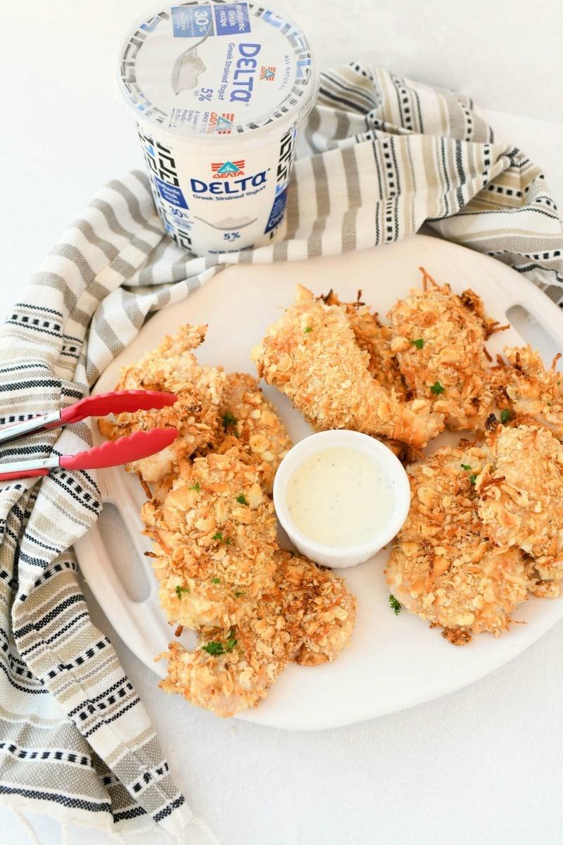 Greek Yogurt cracker chicken on a white platter.