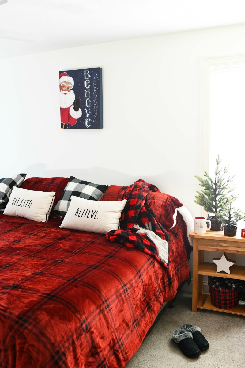 Holiday Buffalo Plaid Bedding in a Christmas themed room.