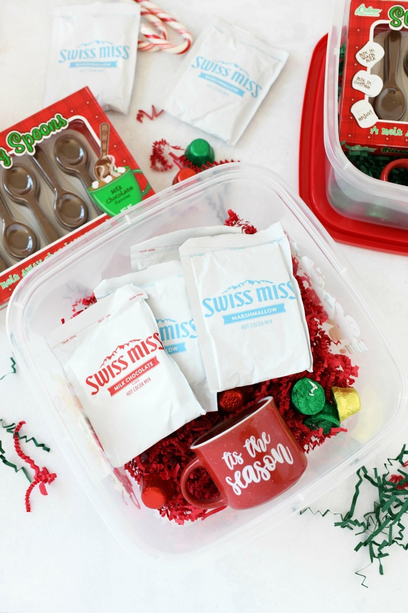 Hot chocolate gift set with hot cocoa packs in a box with candy.
