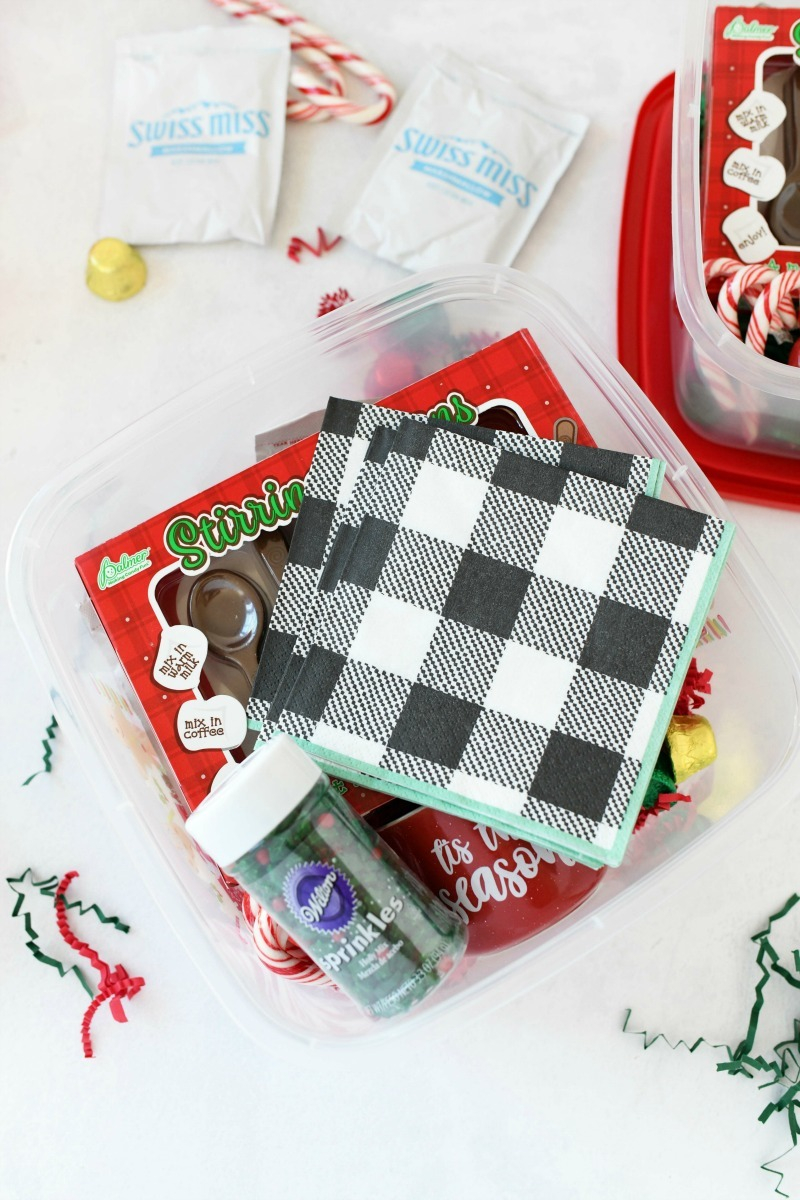 Hot cocoa gift idea with plaid napkins and sprinkles.