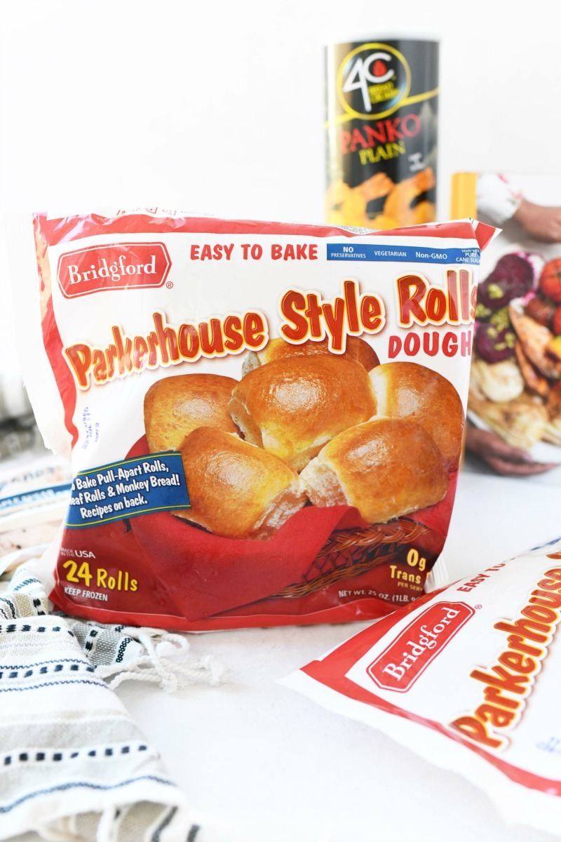 Parkerhouse Rolls on a white table.