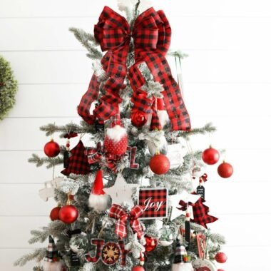Red Plaid Christmas Tree near a shiplap white wall.