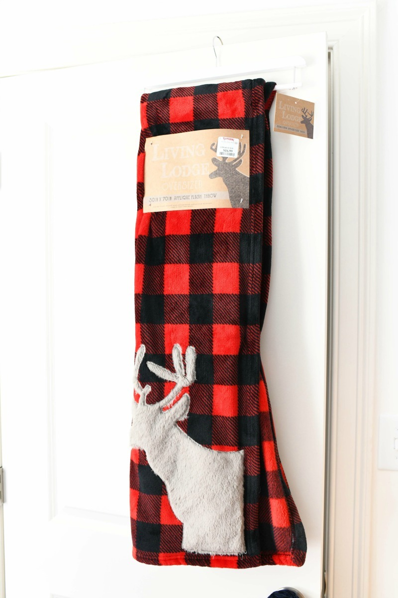Rustic Buffalo Plaid throw over a white door.