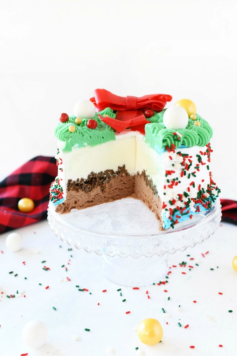 Sliced Carvel Wreath Cake. A buffalo plaid napkin is in the background with candies.