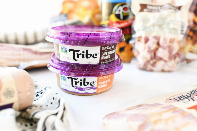 Tribe seasonal hummus on a white table.