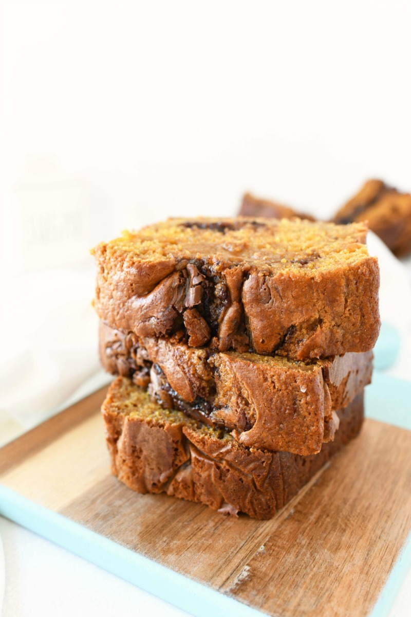 Nutella Pumpkin Bread sliced on a small wooden tray with blue edges.