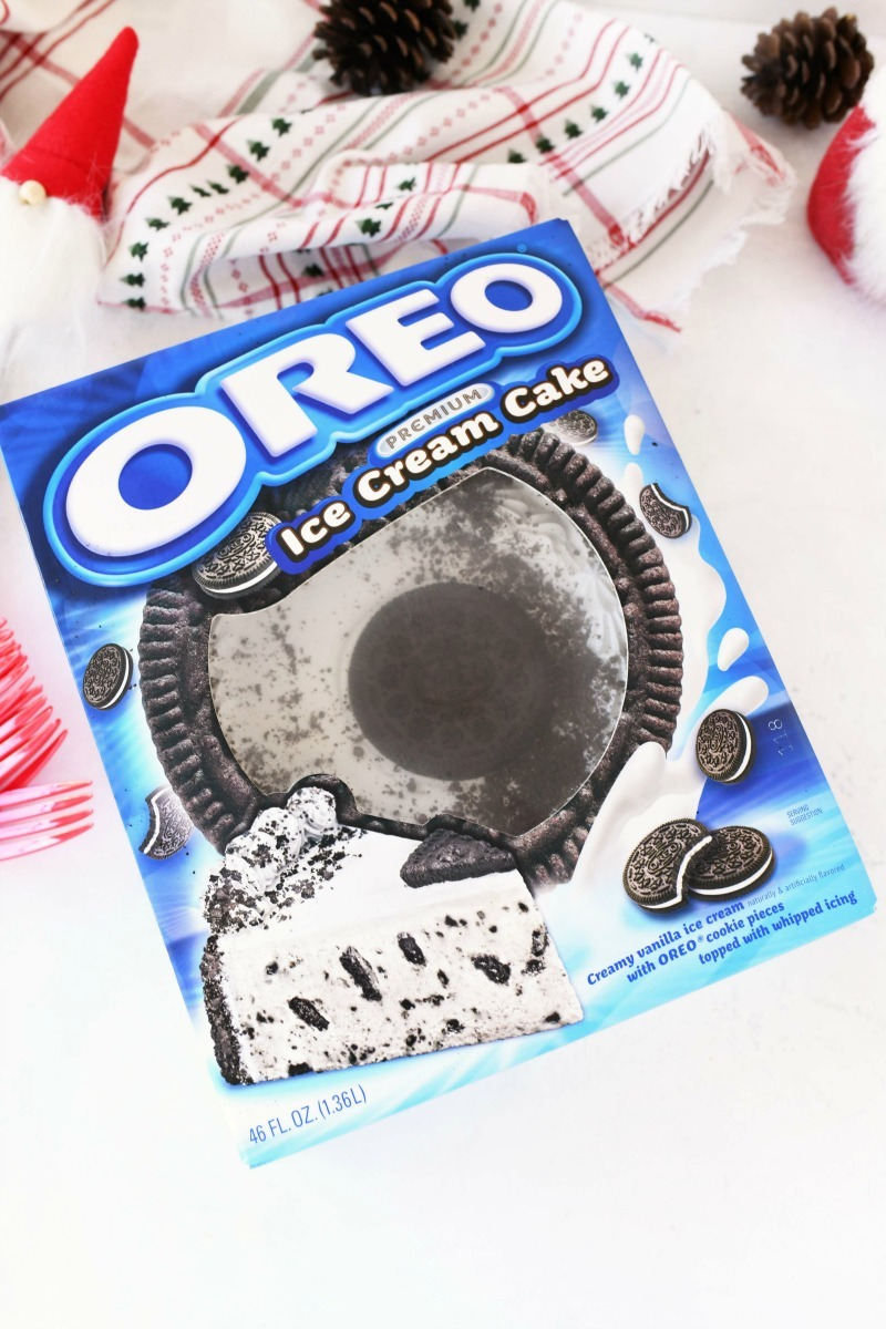 OREO ice cream cake by Carvel in the blue box on a white table.