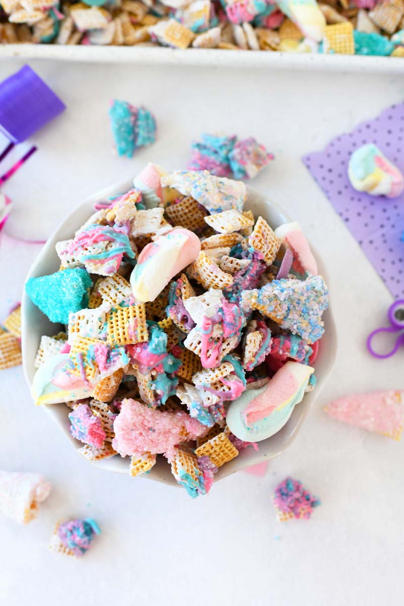 Chex Unicorn Mix in a bowl. There are little pieces around.