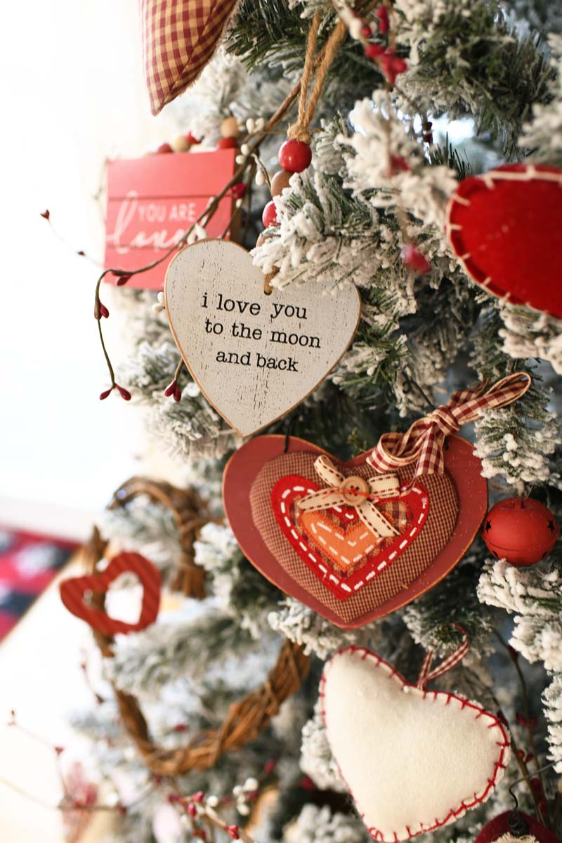 I love you to the moon and back wooden heart ornament on a flocked Valentines Day tree.