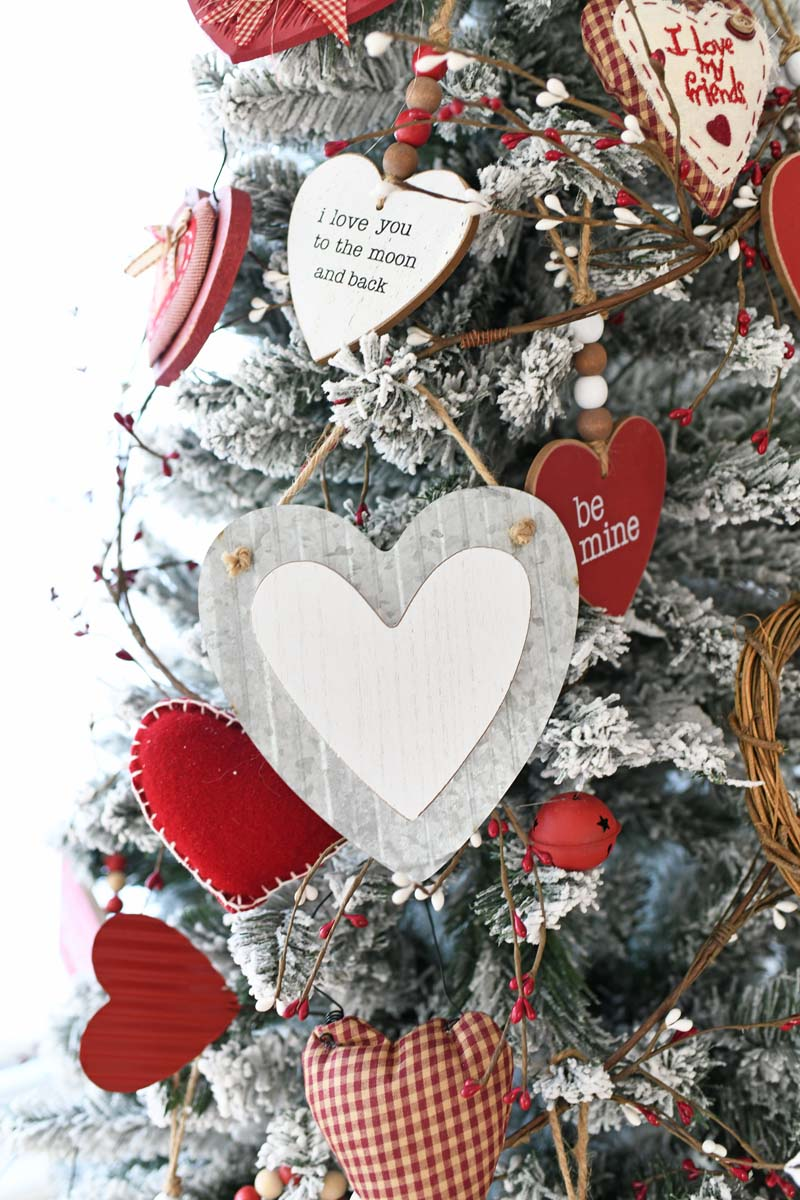 Metal Heart Ornaments hanging on a flocked Valentines Day Tree.