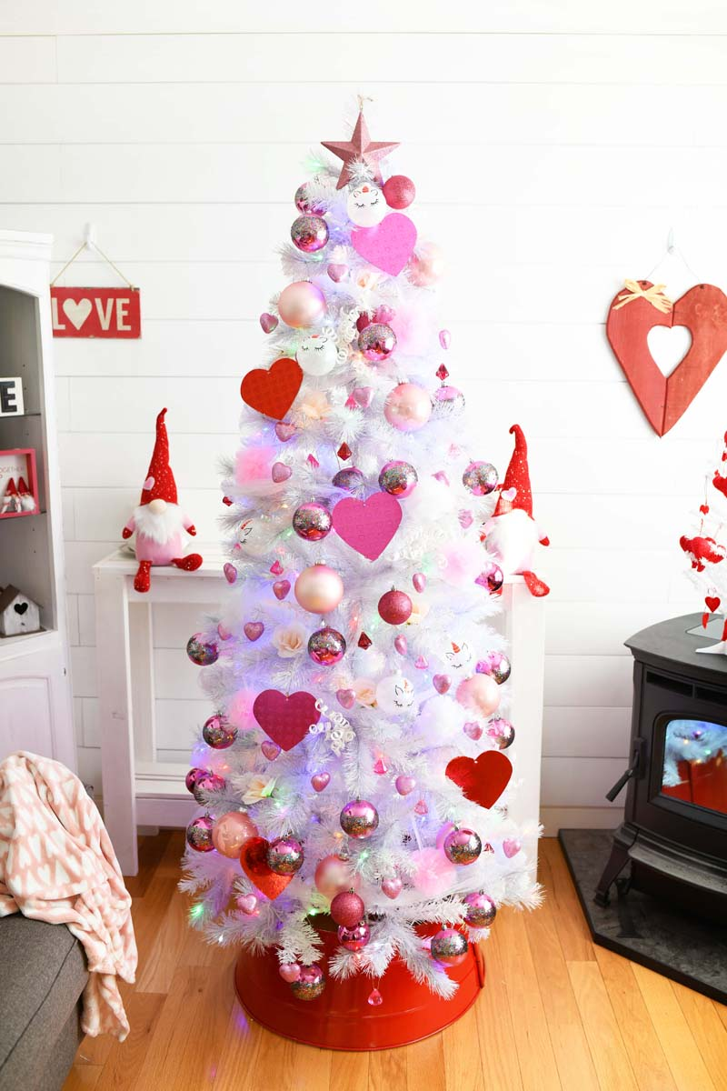 Pink & Red Valentine's Day Tree in a farmhouse style living room. The tree is white with pink and red ornaments.