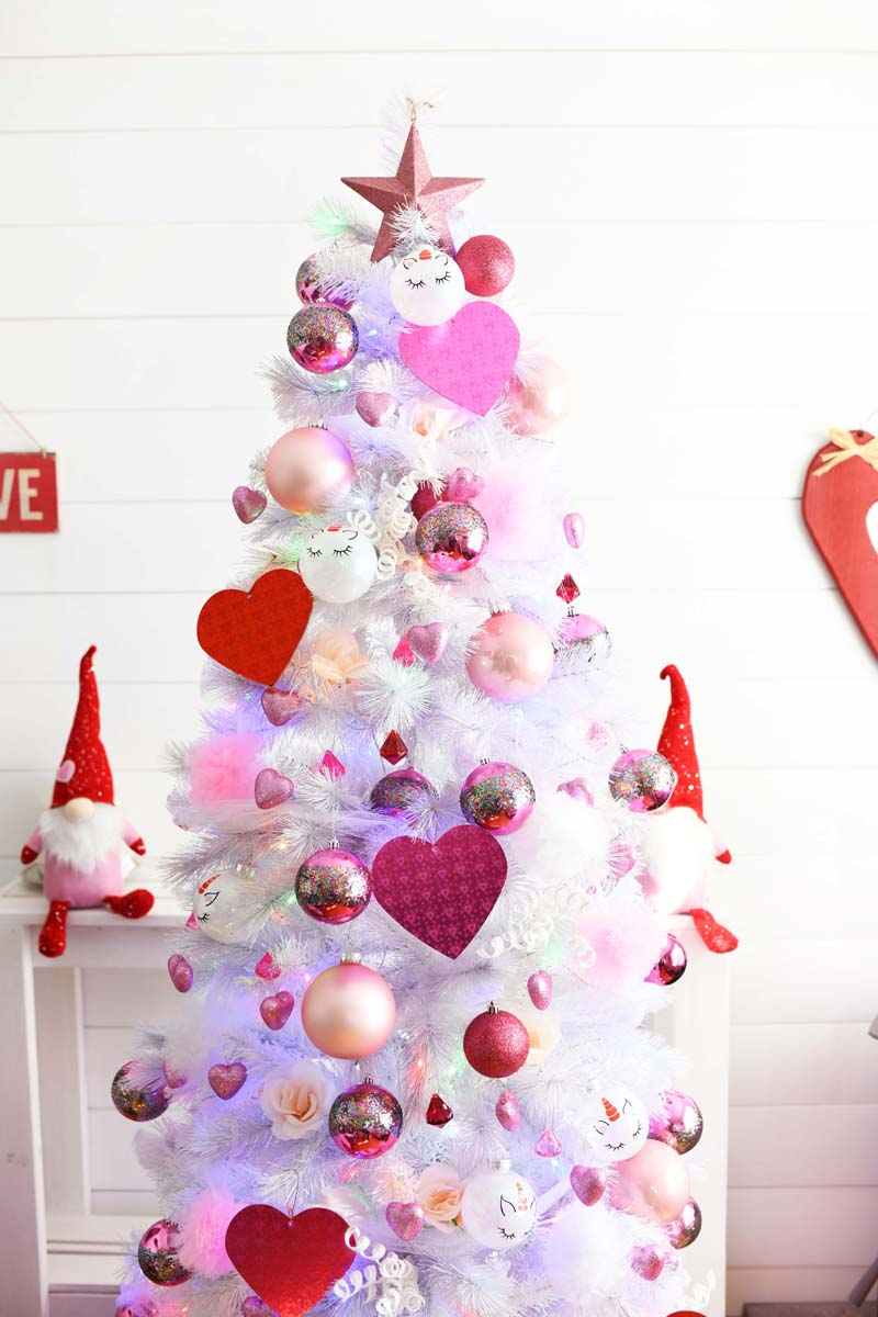 Pink Valentines Day Tree with red and white hearts on a white tree.