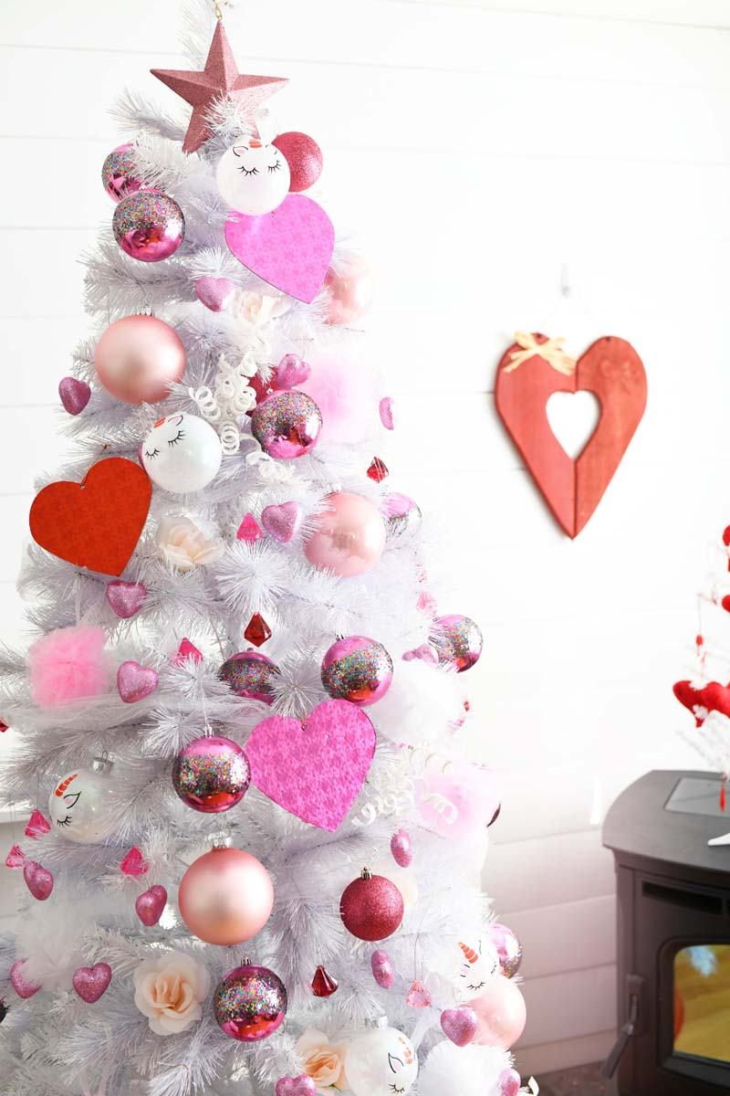 Pink & White Valentines Tree with red and pink heart ornaments.
