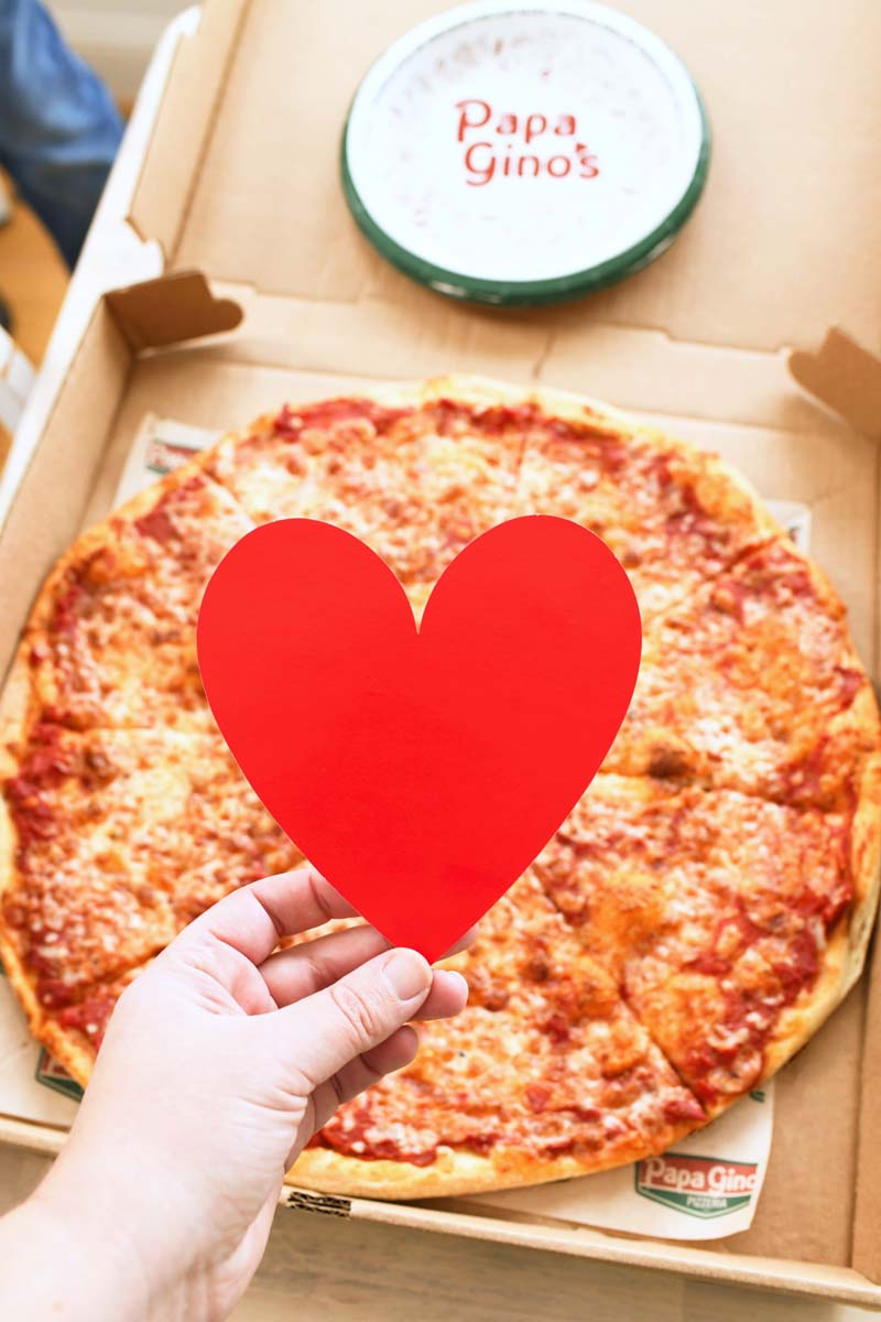 A large Papa Gino's Cheese Pizza with a red heart in the center.