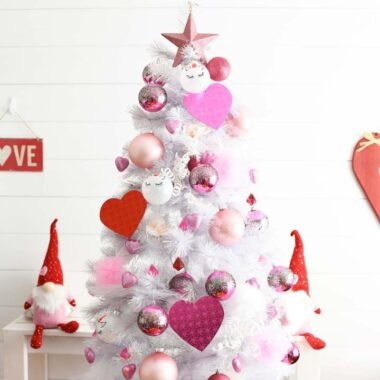 Valentines Day Heart Tree in a white planked walled room. The tree has red and pink décor on it.
