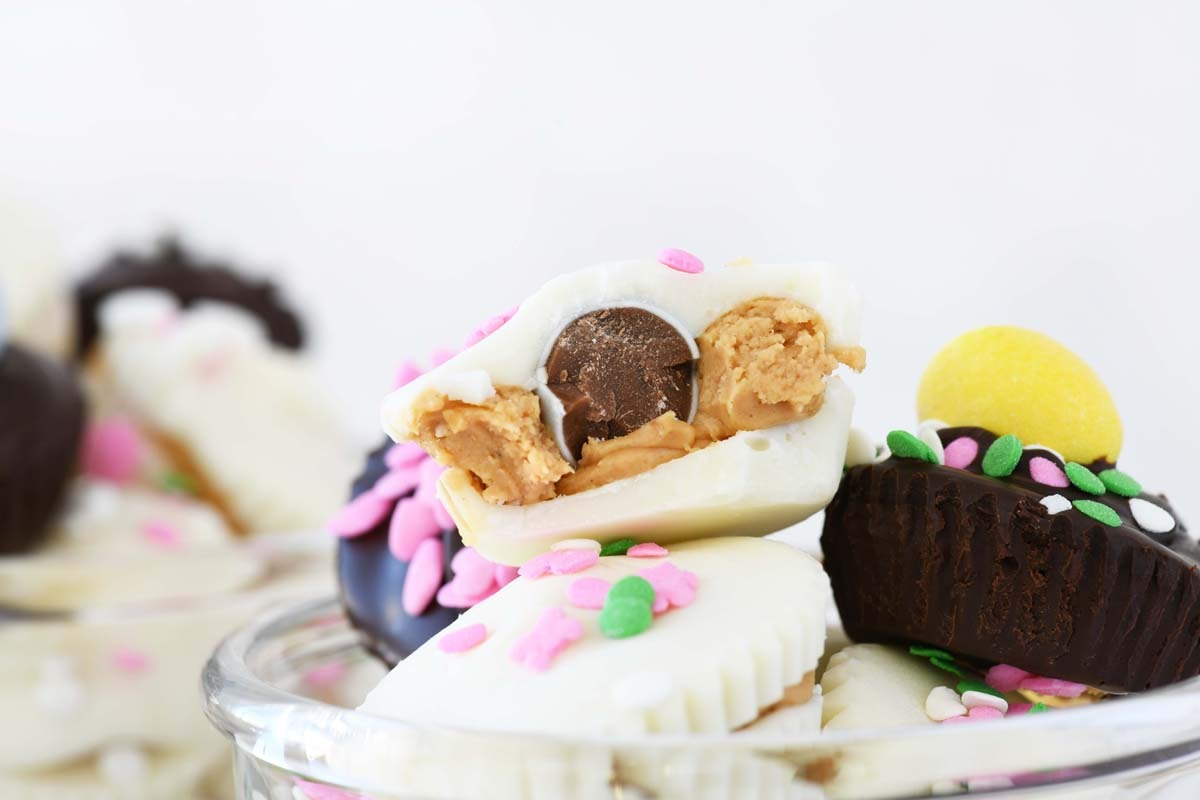 Cadbury Peanut Butter Cups - A inside, up close look of a peanut butter mini cup with a Cadbury Egg inside.