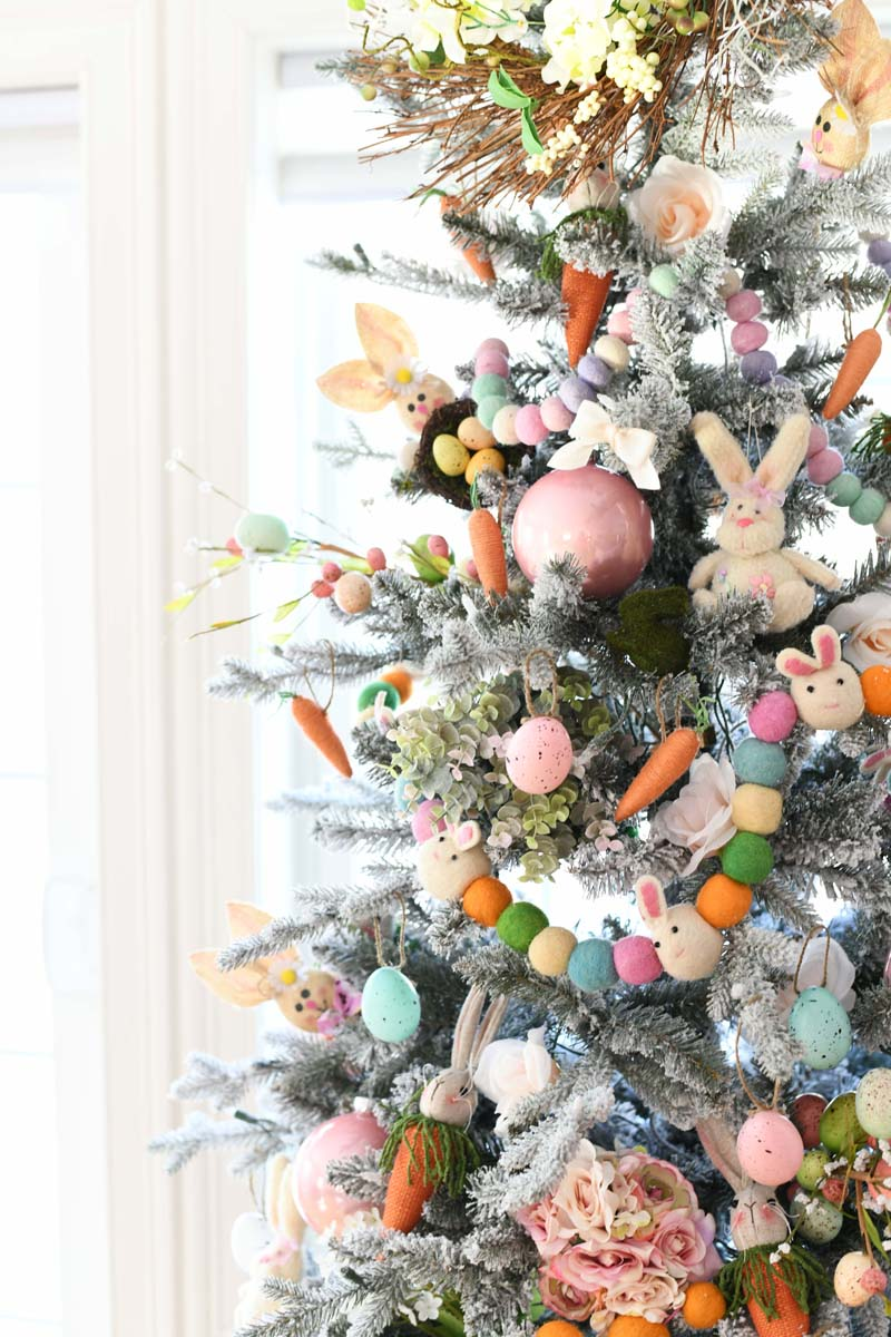 Easter Tree side shot. This pastel colored tree is decorated with bunnies, eggs, and carrots décor.