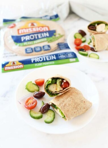 Greek Protein Wrap on a white marble table.