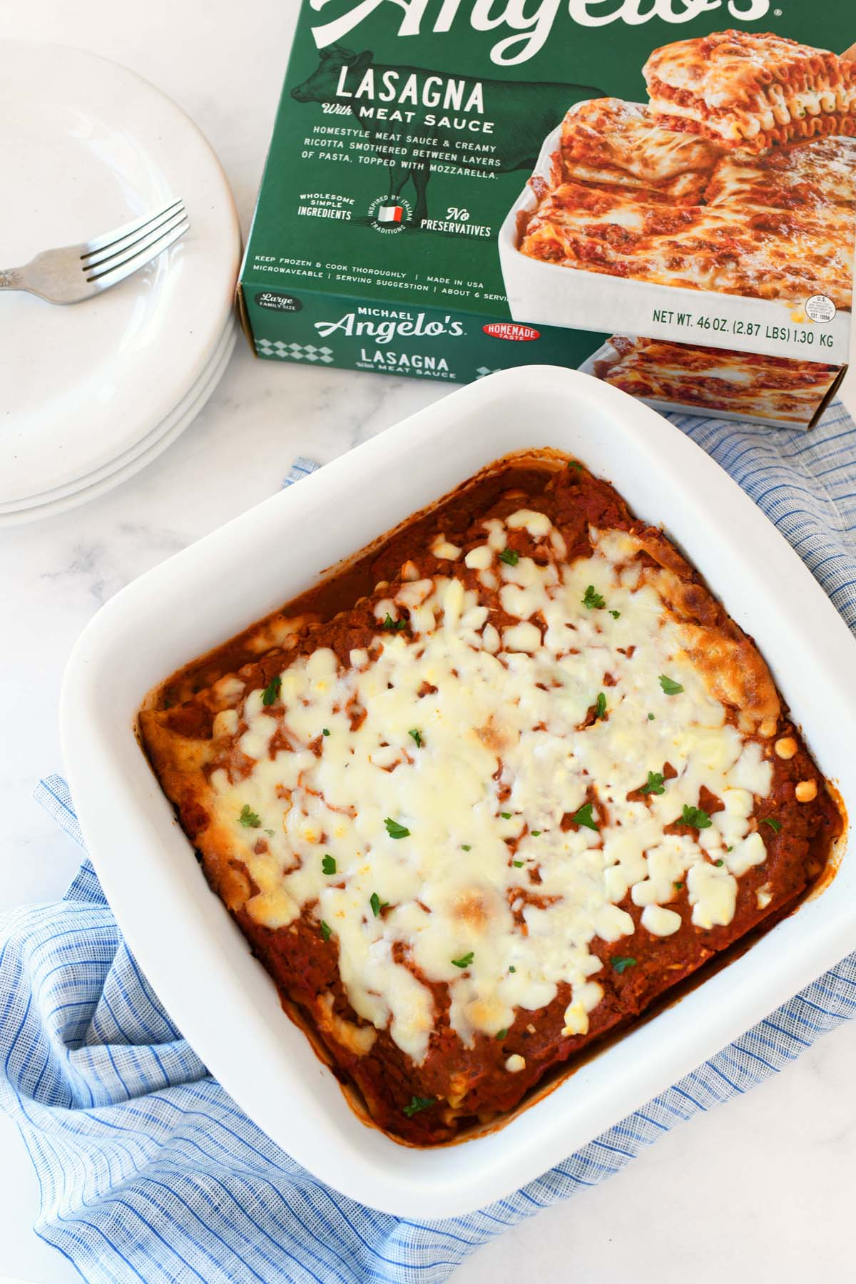 Michael Angelos Meat Lasagna baked in a small white, rectangular dish.