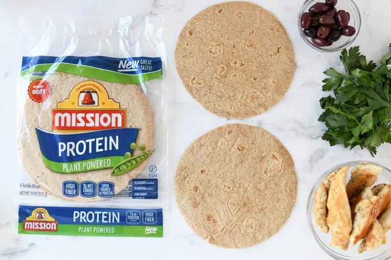Mission Plant Powered Wraps without anything on them on a white marble table.