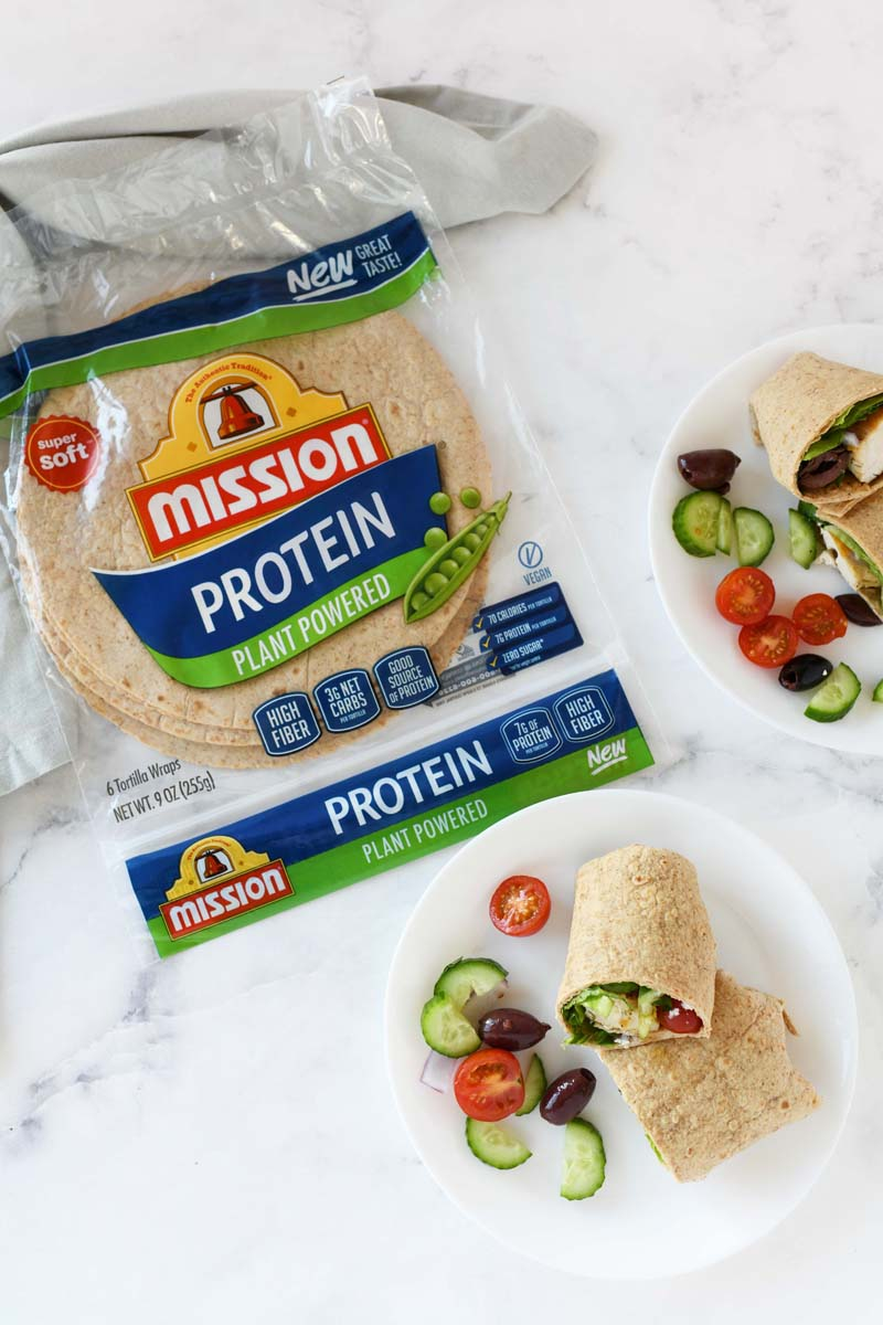 Mission Protein Wraps on a white table. There are assembled wraps and the product on a white, marble table.