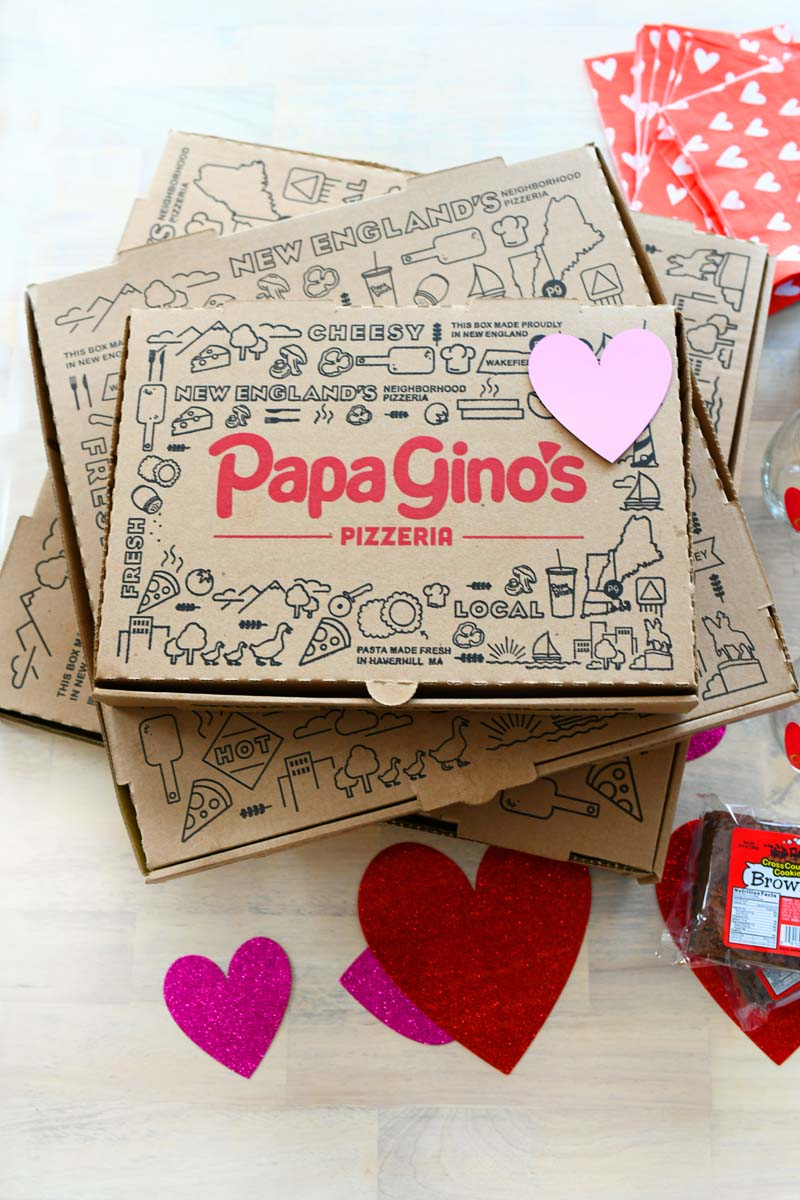 Papa Ginos Boxes with red and purple hearts on them. There is also a pint of Ben & Jerry's in this shot.