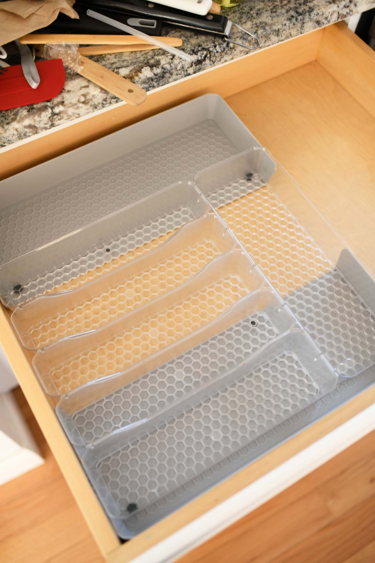 Hexa By Spectrum Expandable Drawer Organizer. Item is inside a drawer, expanded.
