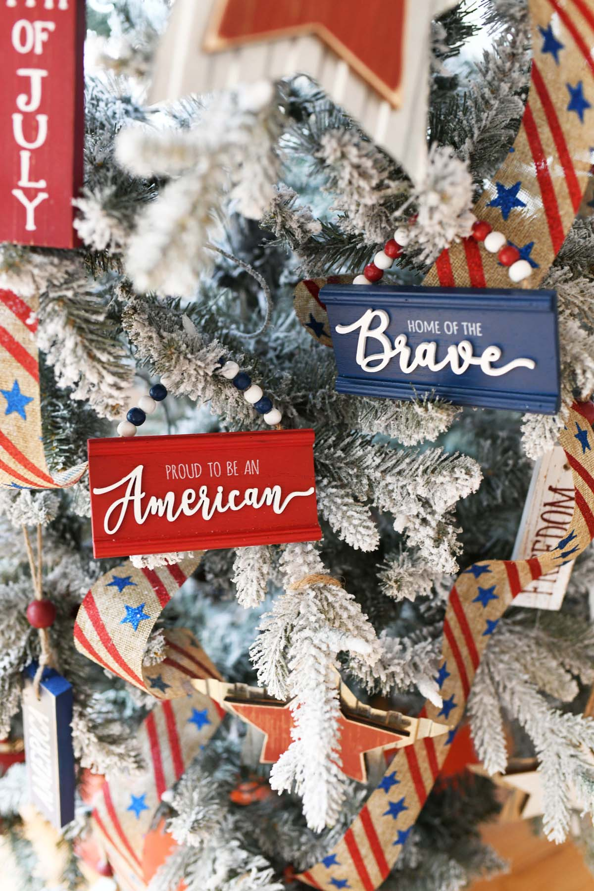 Red, white, and blue Americana Ornaments on a Christmas tree.