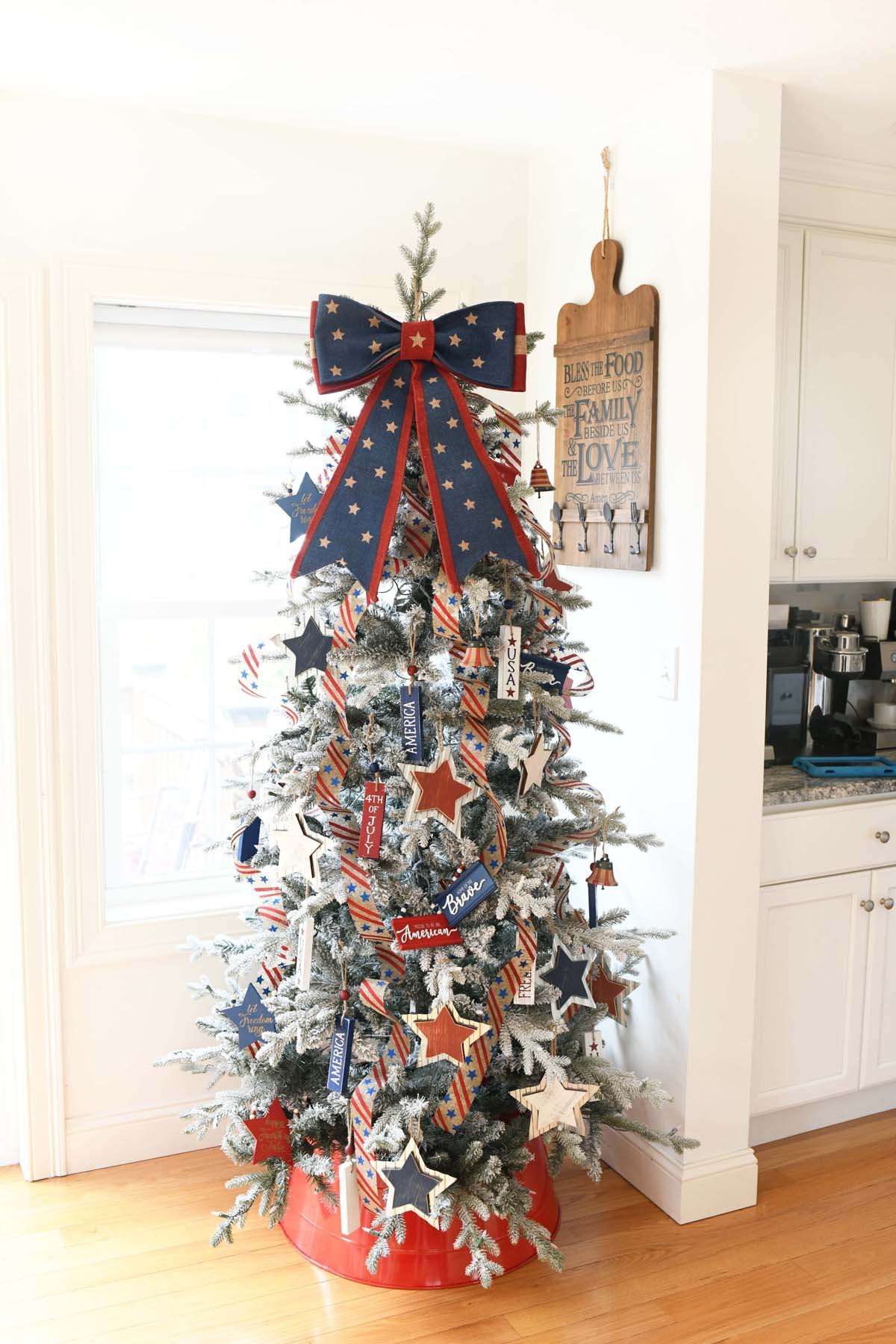 Americana Tree with a red, and blue star bow topper.