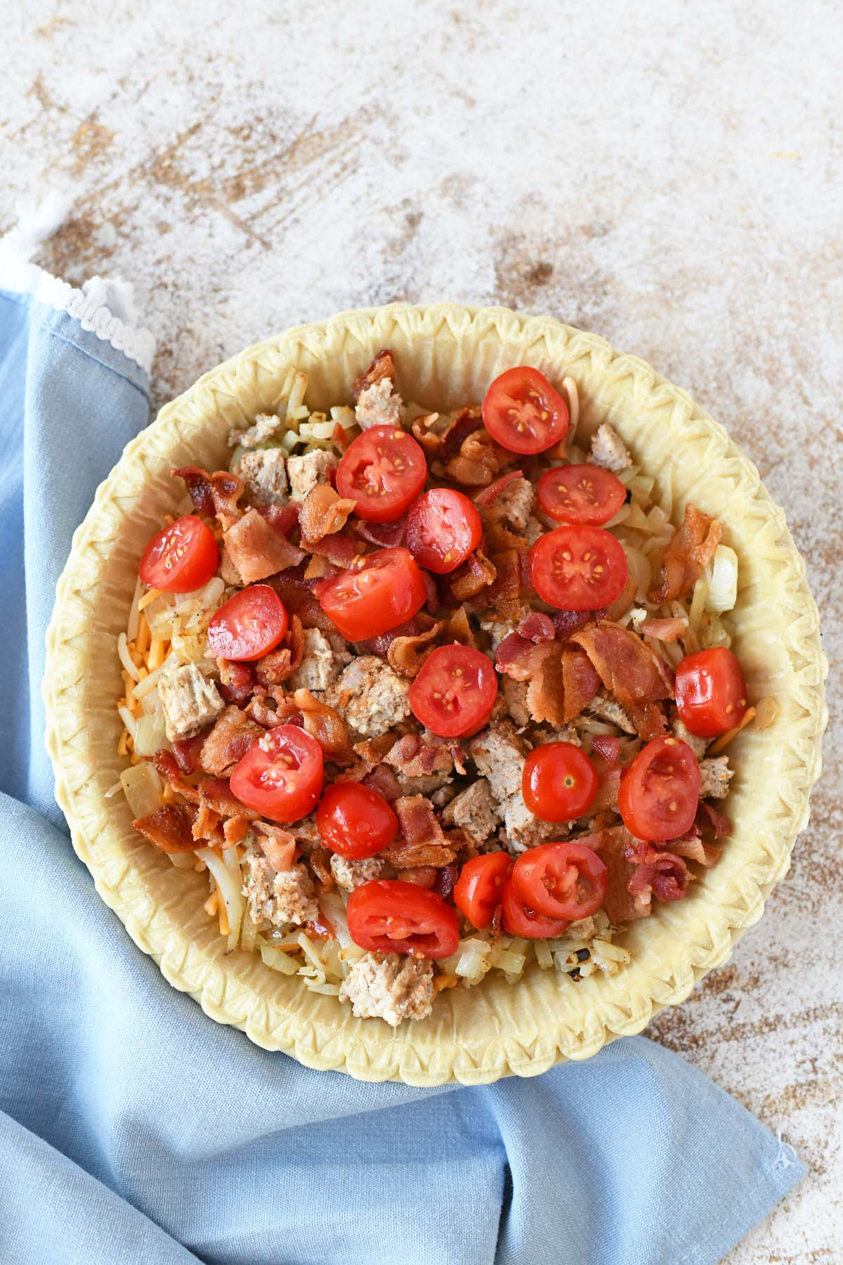 Crisp bacon, sausage, and tomato in a pie shell.