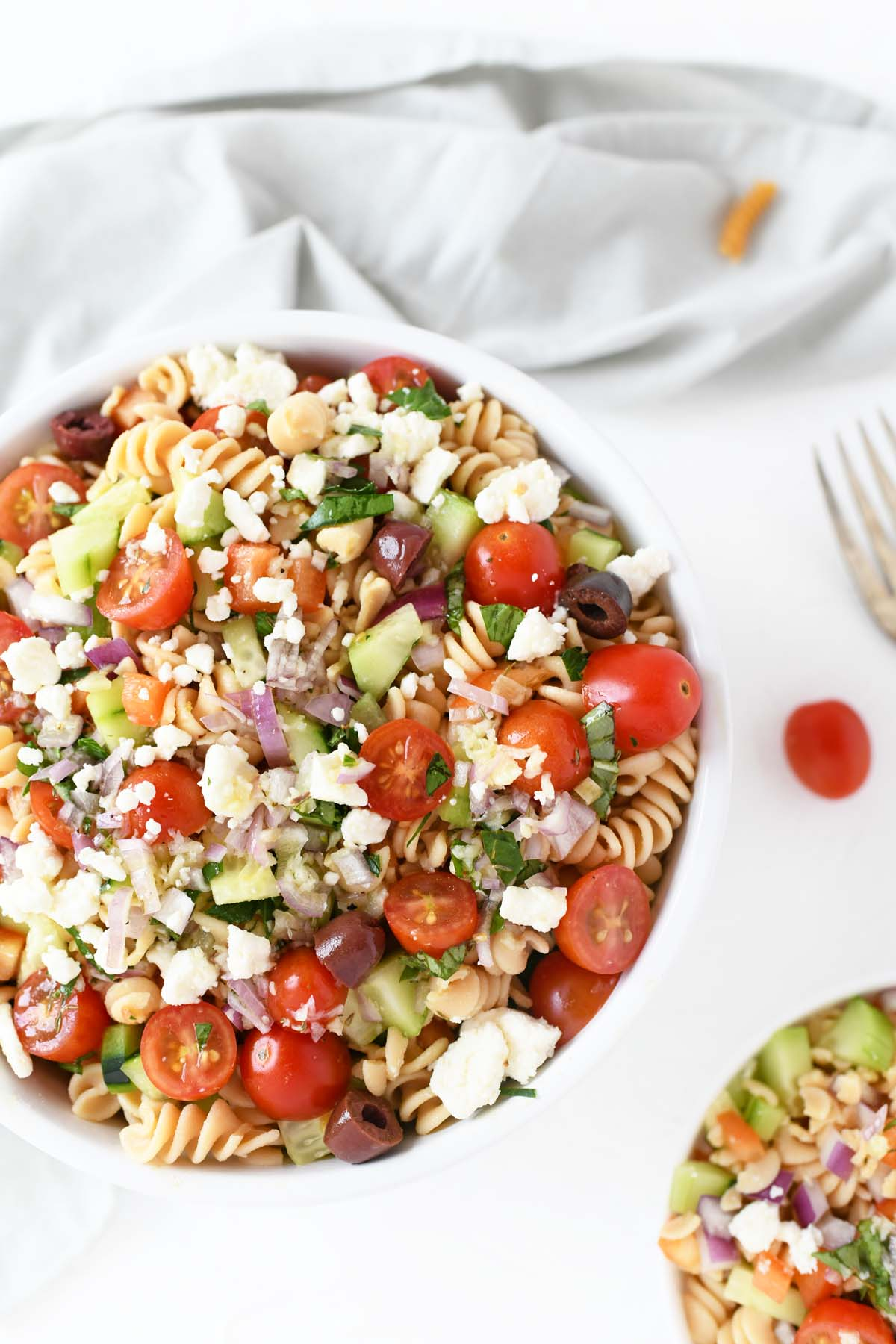 A large bowl of colorful Greek Salad with feta cheese.