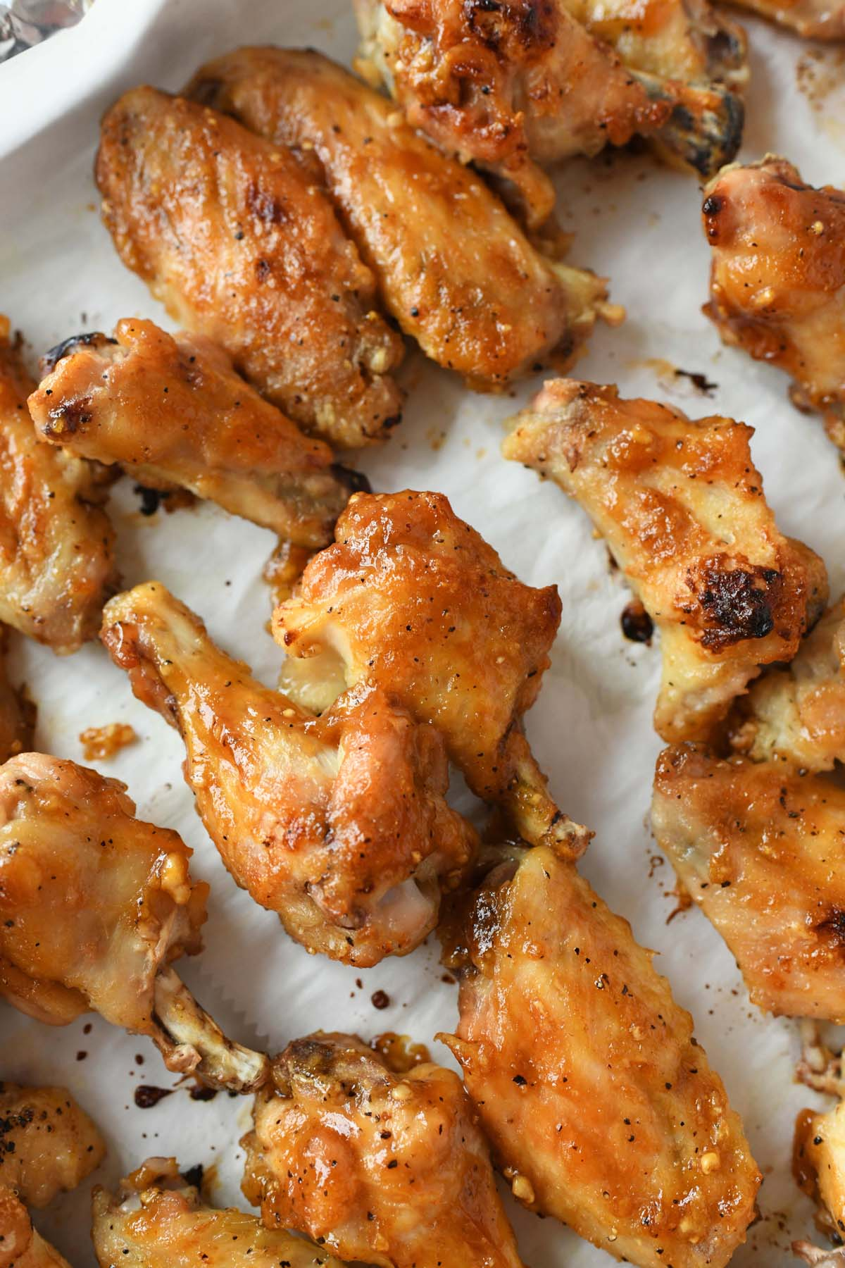 Oven-Baked Honey Garlic Chicken Wings on a baking sheet.