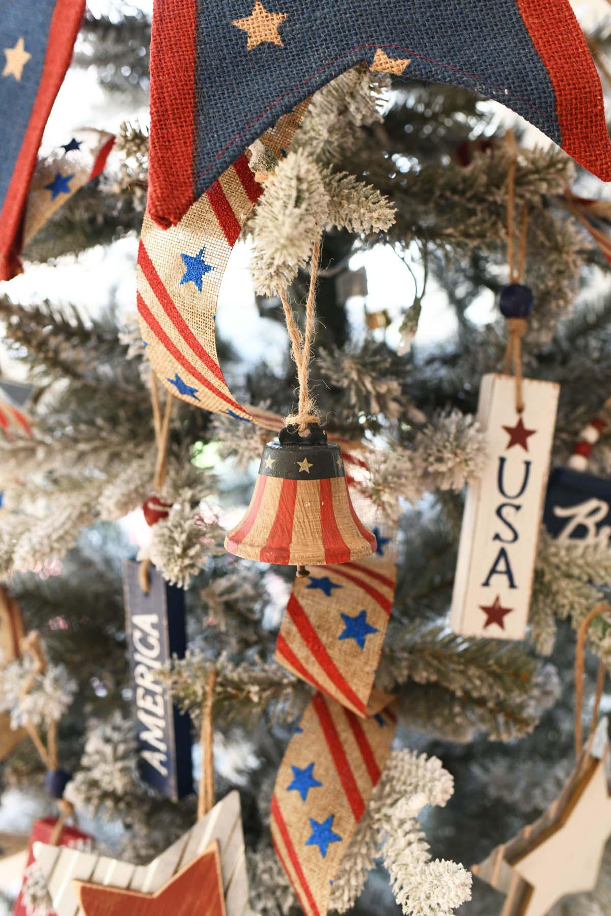 Patriotic Liberty Bell ornament on a Christmas Tree.