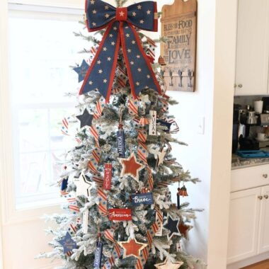 Patriotic Christmas Tree with a red, and blue star bow topper.