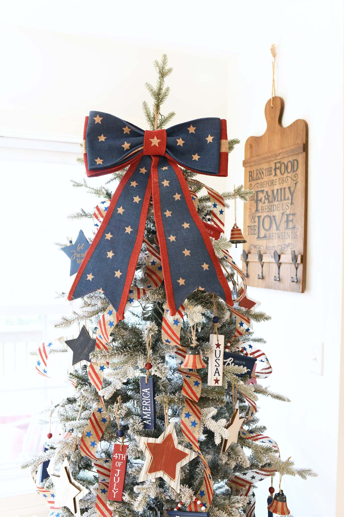 Patriotic Tree with a blue and red burlap star bow.