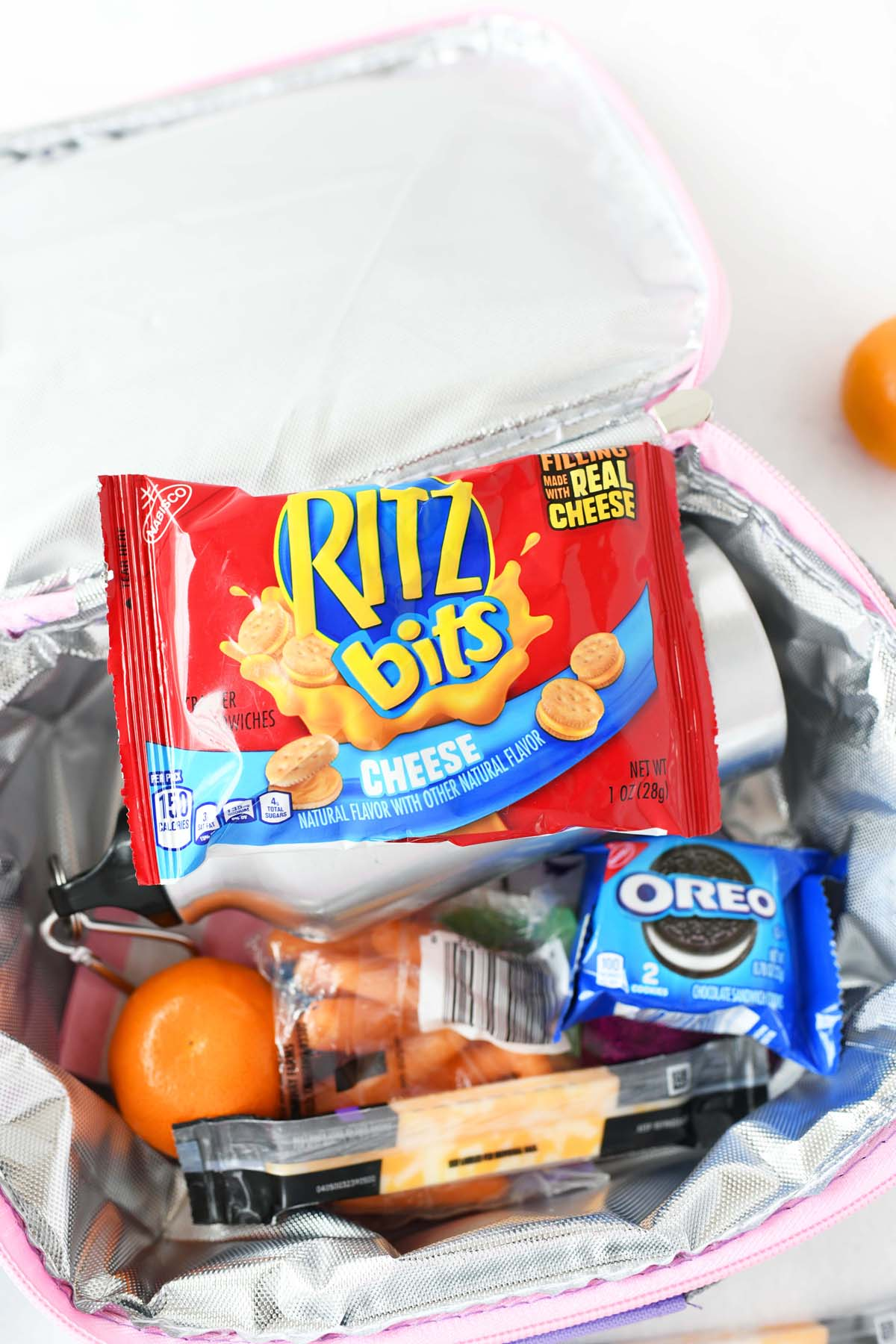 Ritz Bits with Cheese in a kids lunchbox with other snacks.