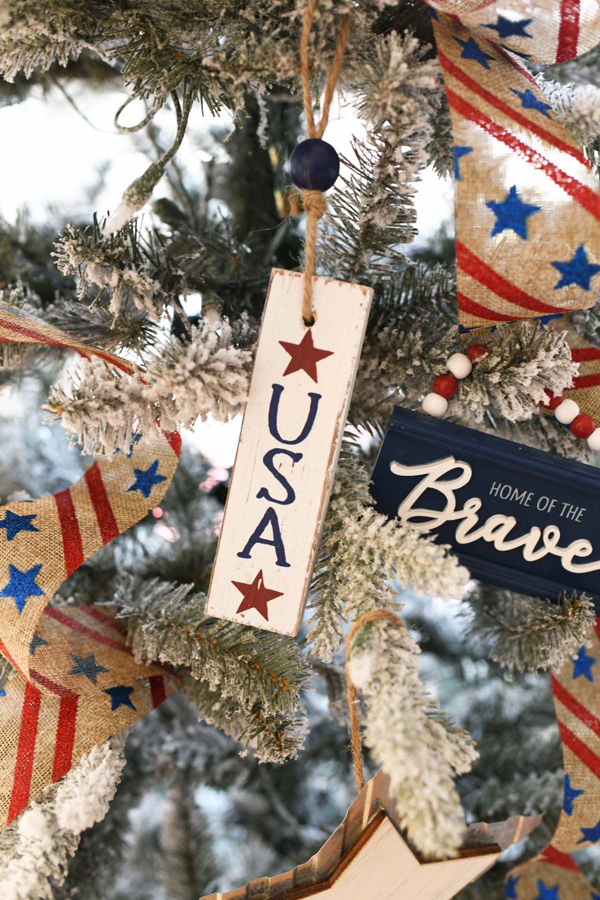 USA wood ornament on a tree.