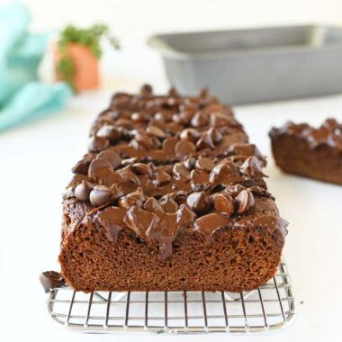 Sliced paleo chocolate zucchini bread on a silver cooling rack.