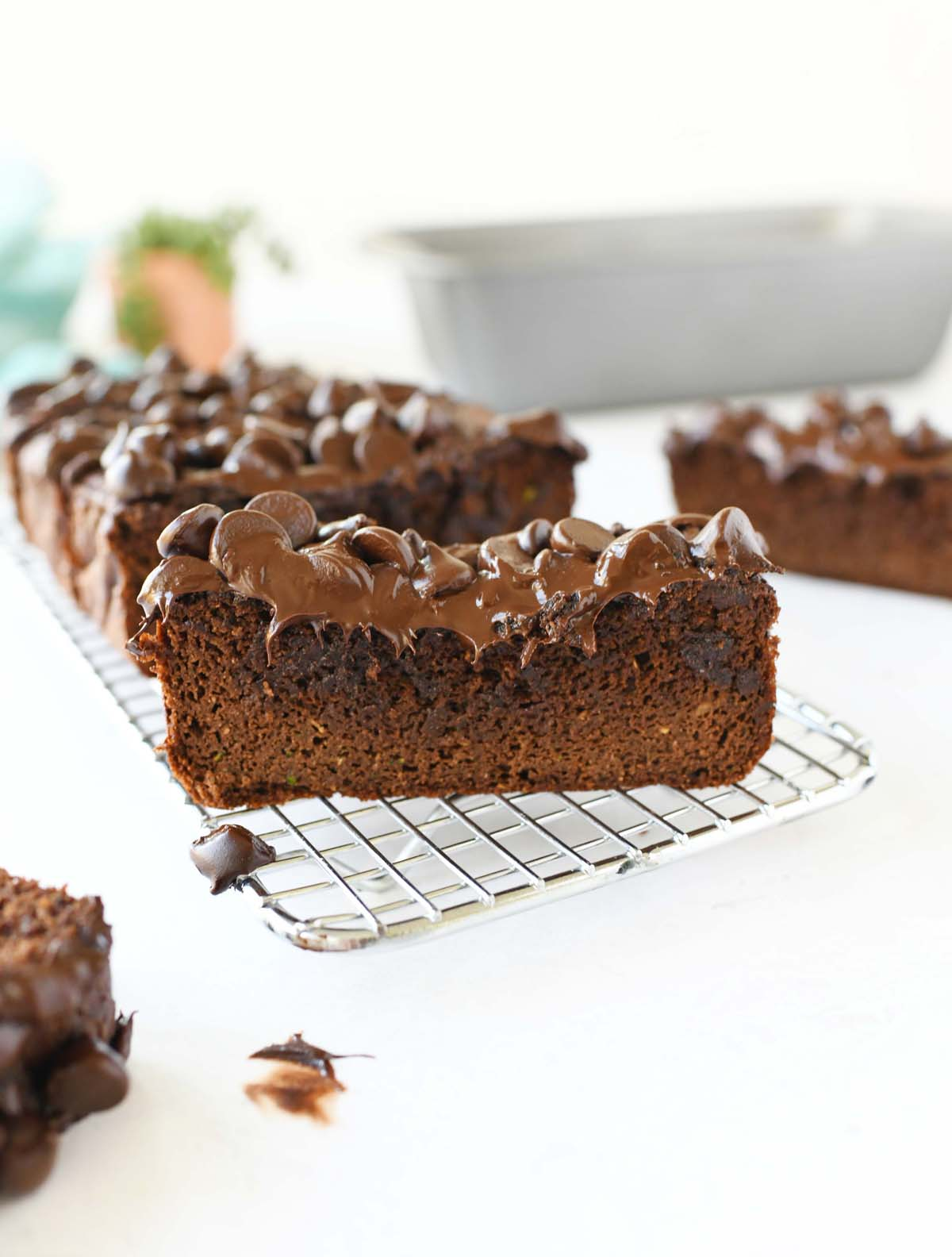 Sliced chocolate zucchini bread with chocolate chips top.