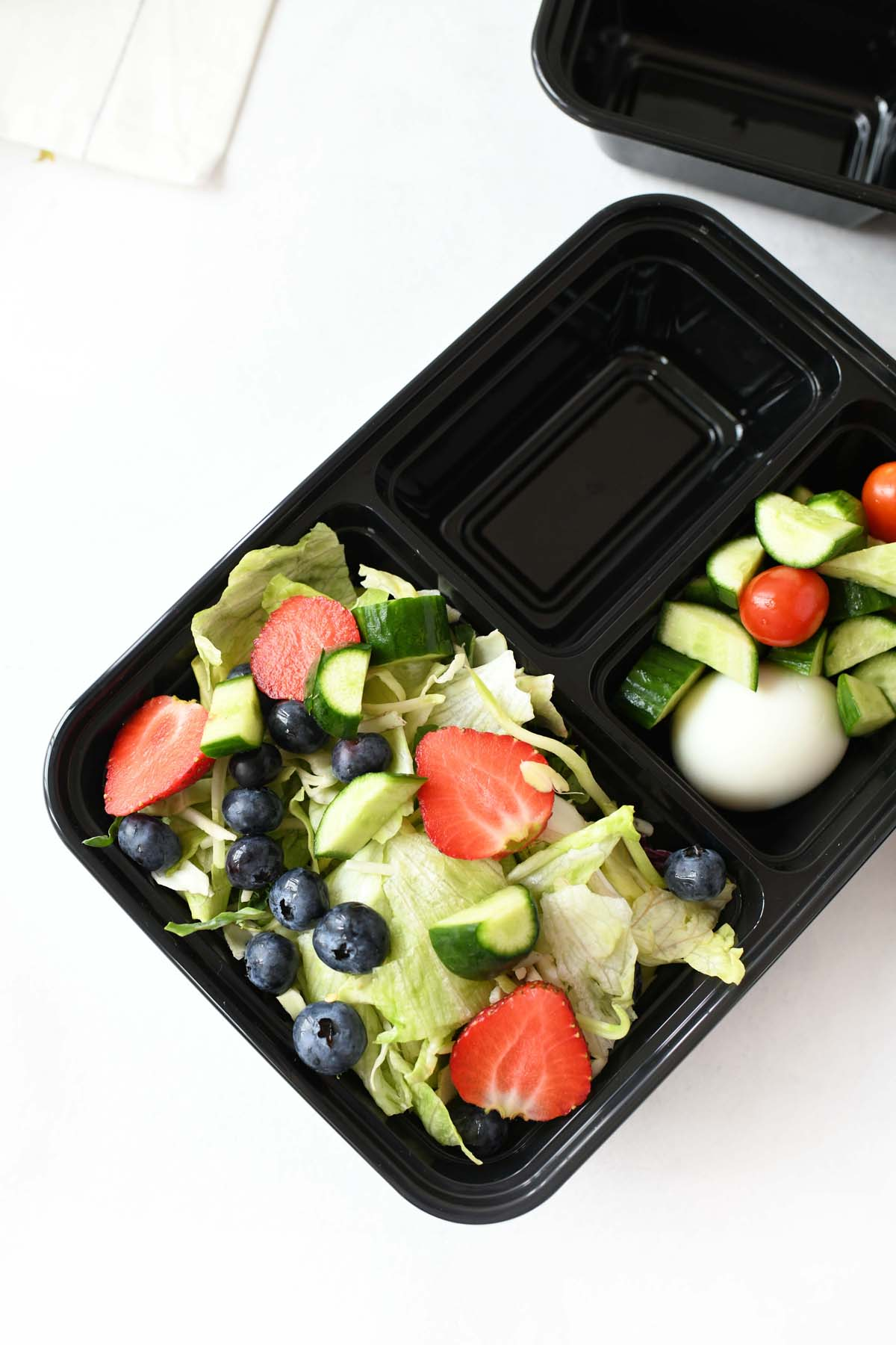 Berry salad in a meal prep container.