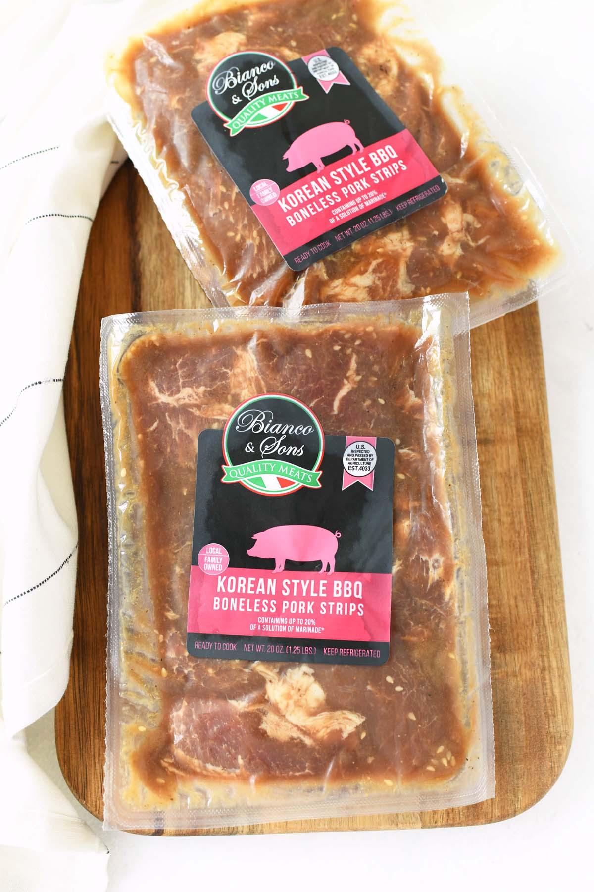 Bianco & Sons packaged of Bianco Korean Style Boneless BBQ Pork on a cutting board.