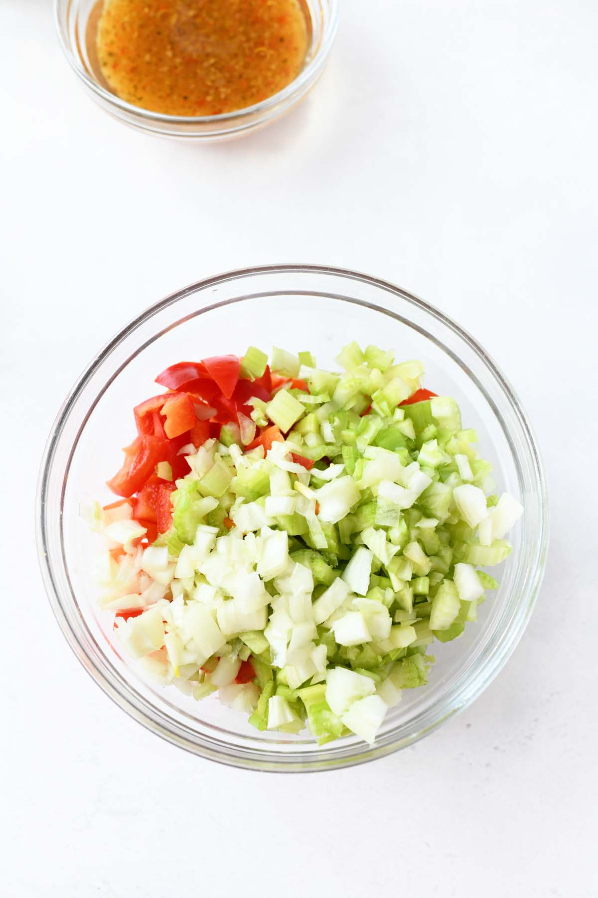 chopped vegetable in a glass bowl.