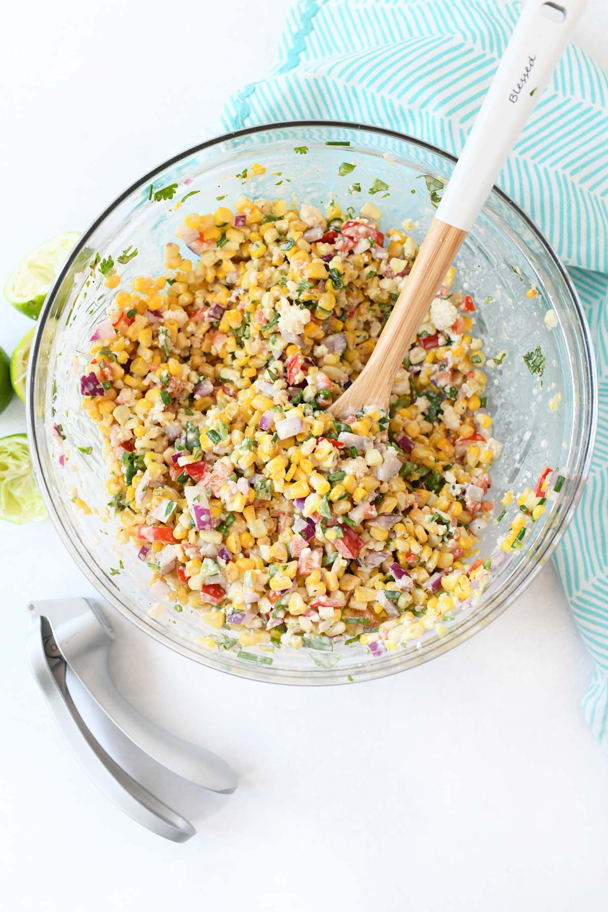 Mexican Street Corn Salad  in a glass bowl with a blue napkin.