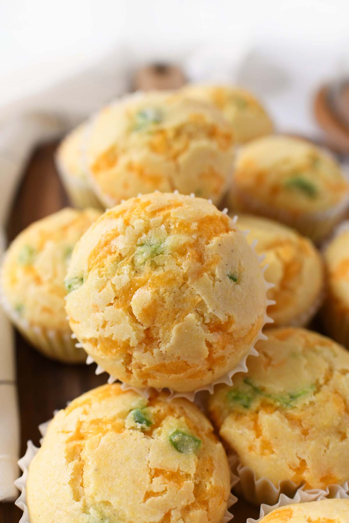A close up shot of stacked jalapeno cheddar corn muffins.