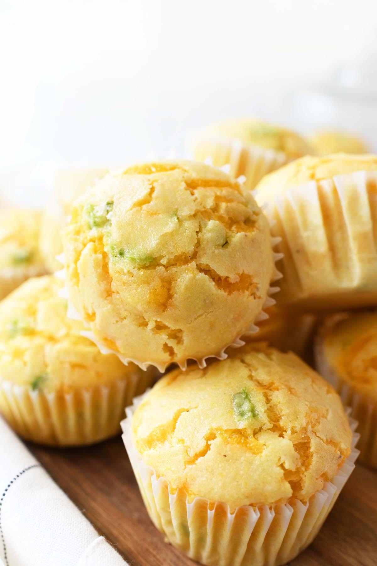 A close up shot of a moist jalapeno cheddar corn muffin.