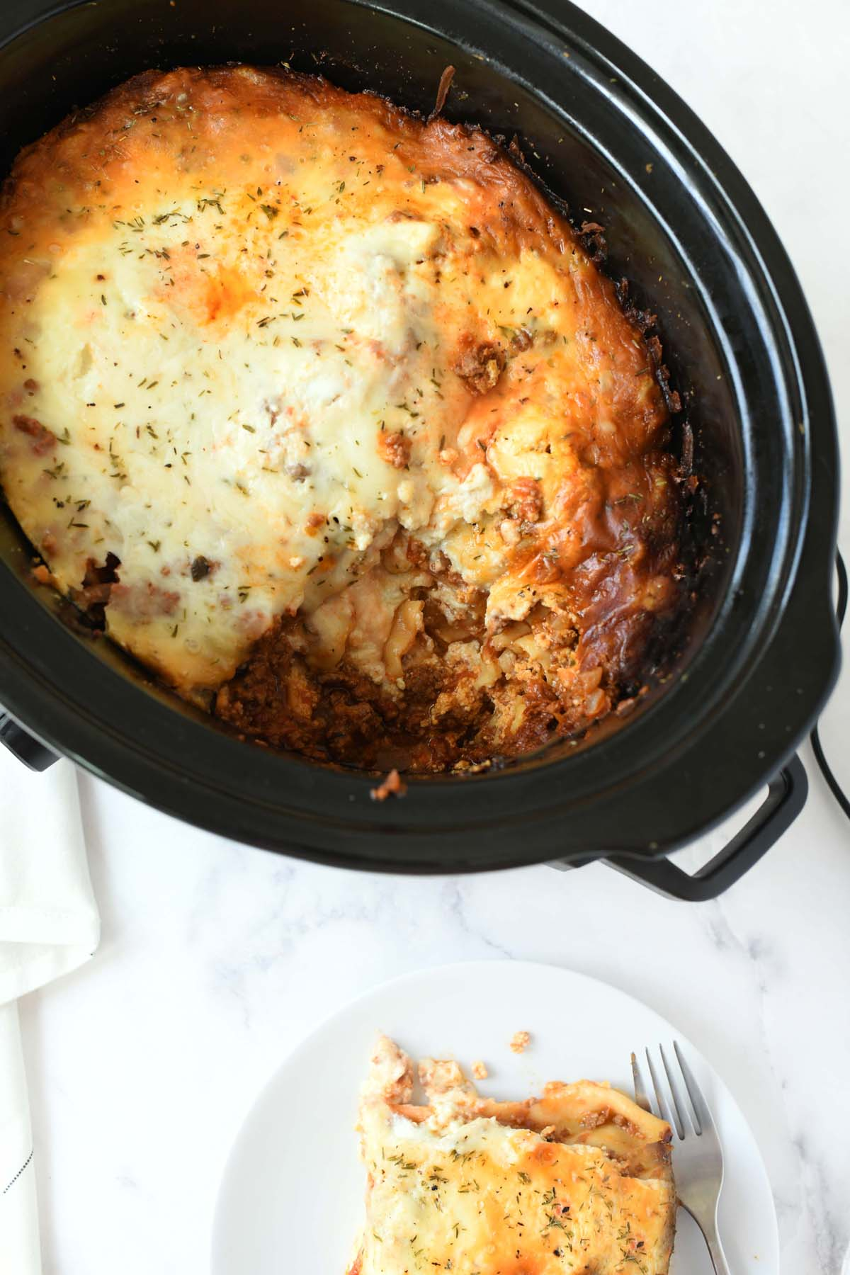 Slow Cooked Lasagna in a black slow cooker.
