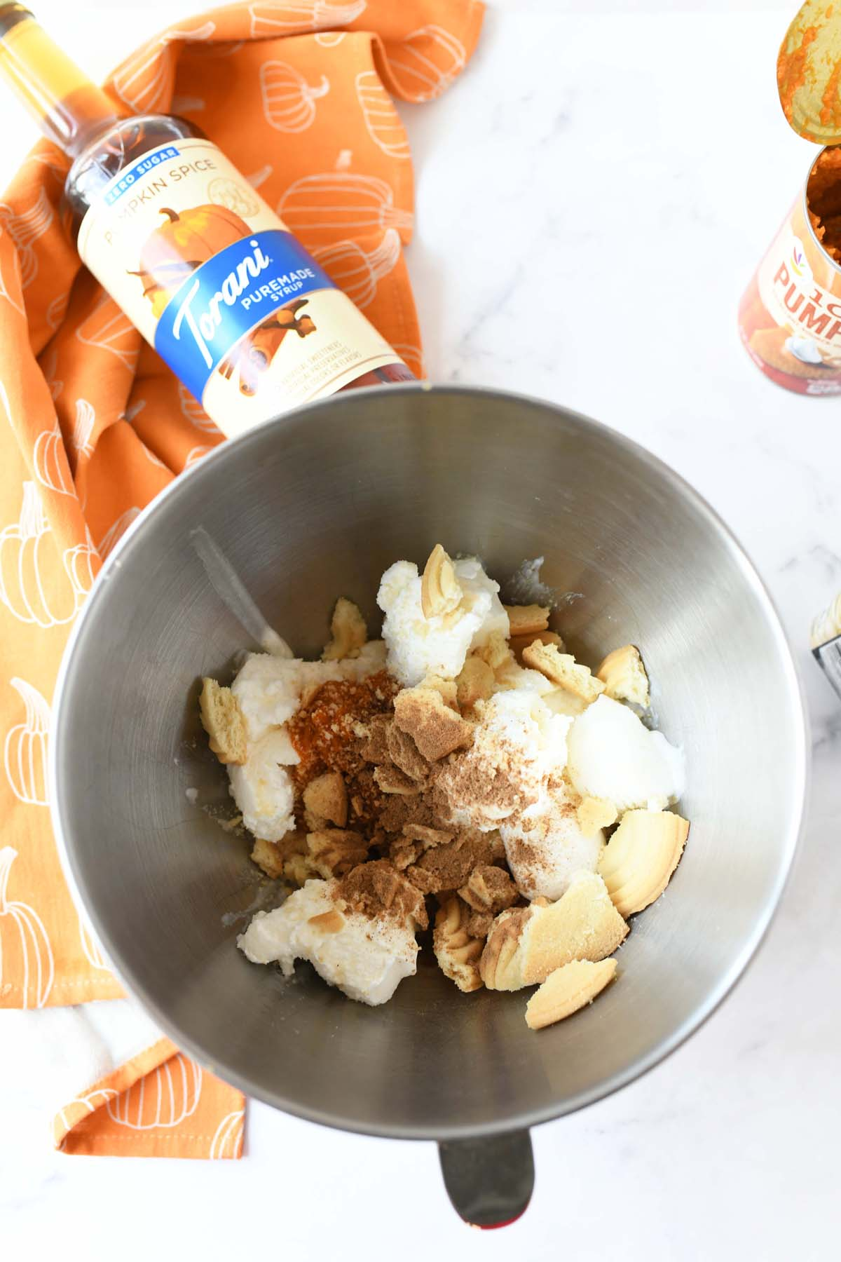 DIY pumpkin milkshake ingredients in a stainless steel kitchenaid bowl.