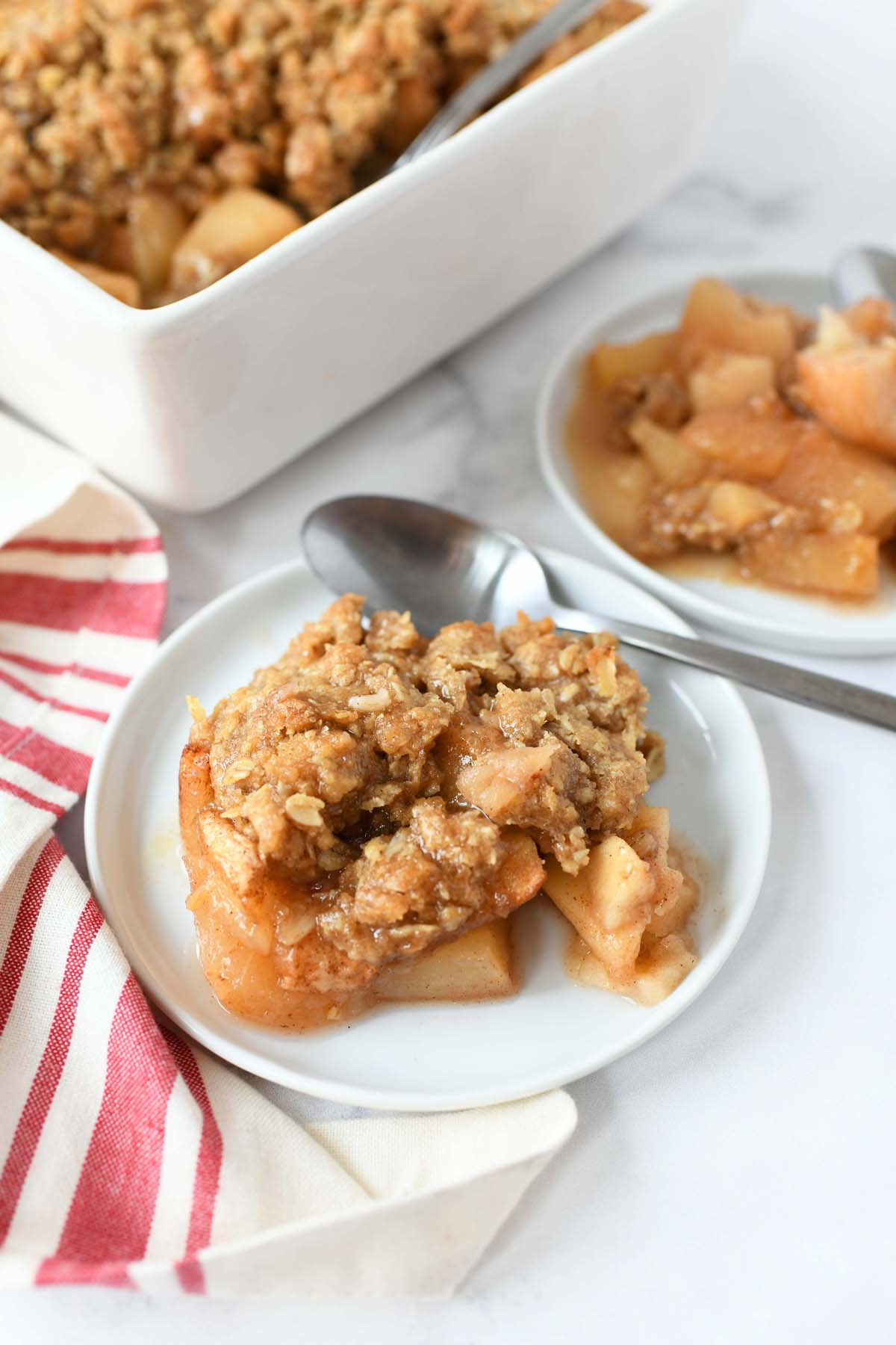 Easy Apple Crisp on a small white plate with a spoon.