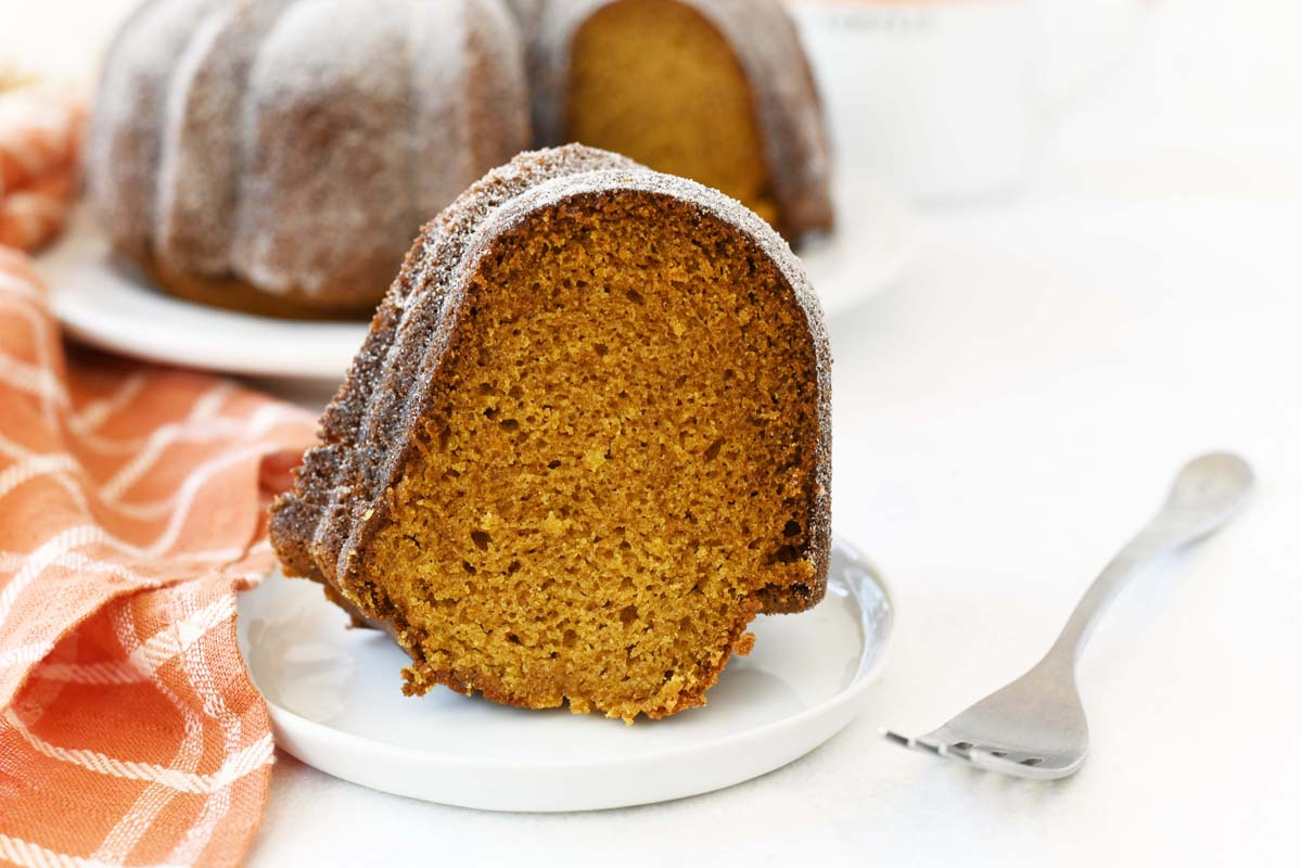 Slice of Cinnamon and Sugar pumpkin cake  with a fork.